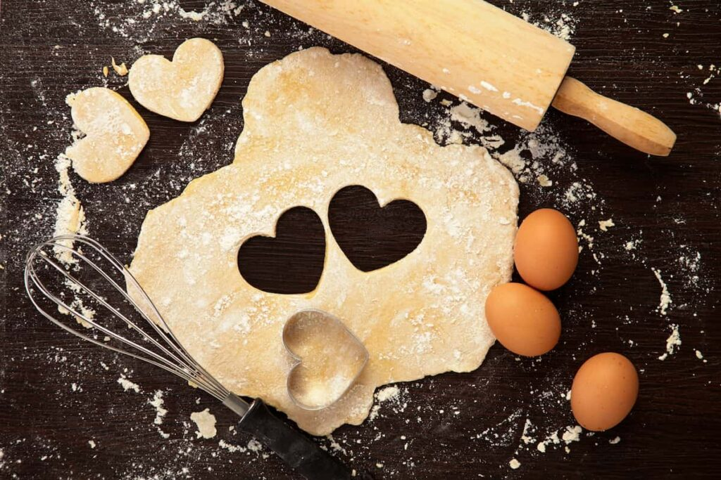 prayer for emotional eating - pie crust rolled out with heart cookie cutter, whisk, and eggs